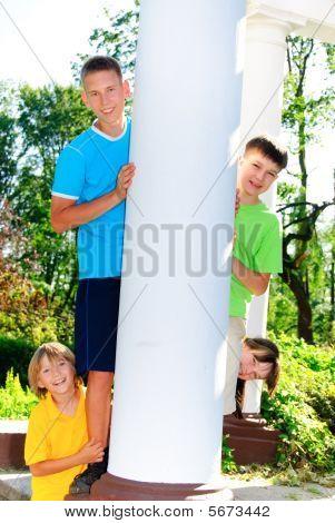 Cousins behind column