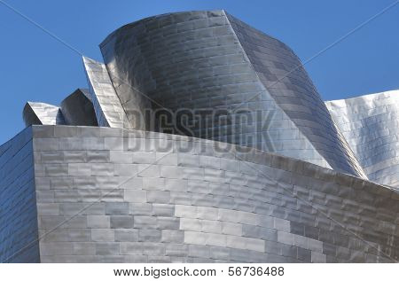 BILBAO - JULY 30: Guggenheim Museum on July 30, 2011. Titanium facade of the  Guggenheim Museum. This Museum is dedicated  exhibition of modern art and was  designed by architect Frank Gehry.