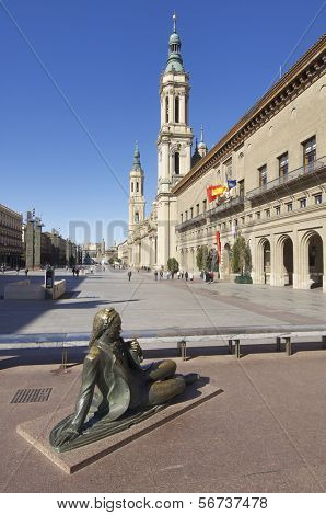 ZARAGOZA, SPAIN - NOVEMBER 16: Pilar Square on November 16, 2011 in Zaragoza: bronze  sculpture dedicated to the painter Francisco de  Goya in the Pilar Square, behind the Town Hall and Pilar church
