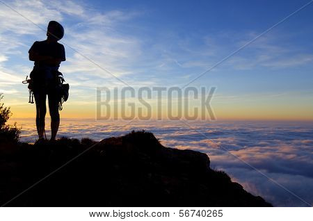 silhouette of a climber with  sunset and sea of ??clouds, Cap of Ras, Ager,  Lleida, Catalonia, Spain