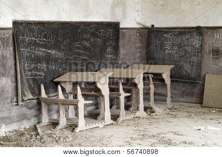 abandoned desks in a old school