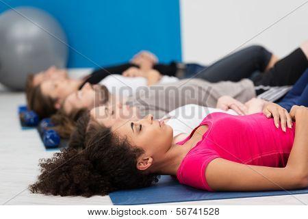 Aerobics Class Practising Deep Breathing