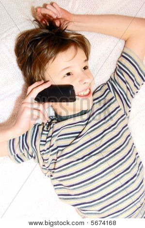 Teen Boy Talking On Cell Phone