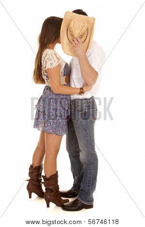 Couple Kiss Behind Cowboy Hat