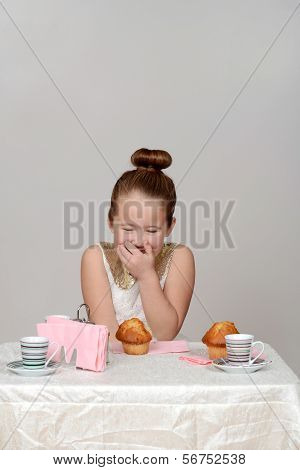 little girl giggling at tea party