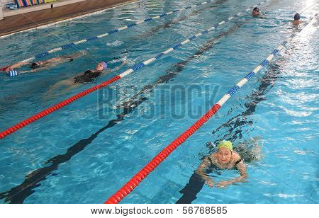 People Of Different Gender And Age, In  Public Swimming Pool.