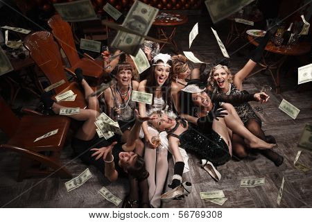 Beautiful women  in the rain of money