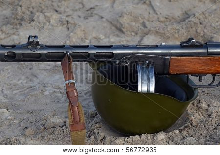 KIEV, UKRAINE -NOV 3: Soviet  machine gun and helmet of WWII (Red Star military history club) during historical reenactment of WWII, Dnepr river crossing 1943, November 3, 2013 Kiev, Ukraine