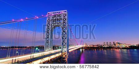 George Washington Bridge at sunset panorama over Hudson River.