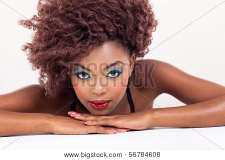 attractive young african beauty on plain background