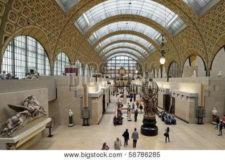 PARIS, FRANCE - SEPTEMBER 12, 2013: Visitors in the Musee d'Orsay. Opened in 1986, the museum houses the largest collection of impressionist and post-impressionist masterpieces in the world