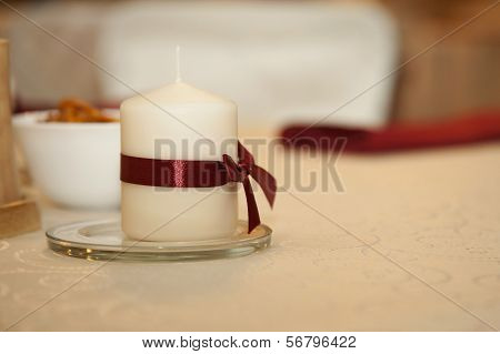 White Candle On A White Table
