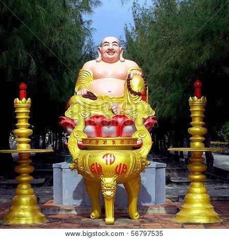 Maitreya Buddha figure at the entrance to a Buddhist monastery