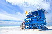 stock photo of lifeguard  - Siesta Key Beach Florida USA colorful lifeguard house on a beautiful summer day with ocean and blue cloudy sky - JPG