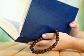 stock photo of rosary  - Hands with rosary and holy book - JPG