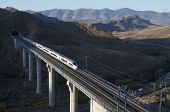 view of a high-speed train crossing a viaduct in Purroy, Saragossa, Aragon, Spain; AVE Madrid Barcel