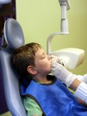 stock photo of crooked teeth  - Male child being prepped for a pediatric dental x - JPG