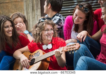 Cool adolescents playing music on the city street