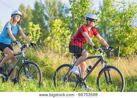 Couple Training Together  On Bikes