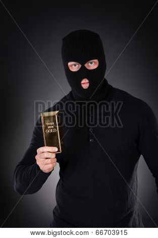 Robber Holding A Gold Bullion Bar