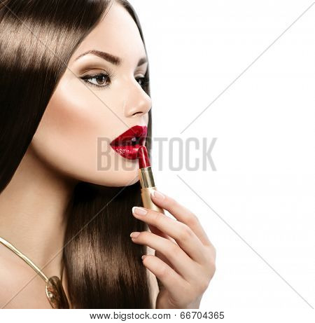 Red Lipstick. Professional Perfect Make-up. Makeup. Lipgloss. Beauty Girl Applying Lip stick. Beautiful sexy model woman with shiny long brown hair and smooth skin isolated on white background
