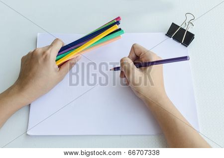 Man Commencing Sketching In A Sketch Book