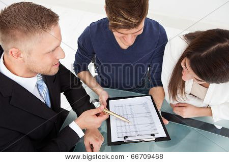 Financial Advisor Explaining Investment Plan To Couple