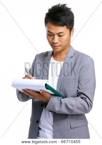 Business man writ on clipboard