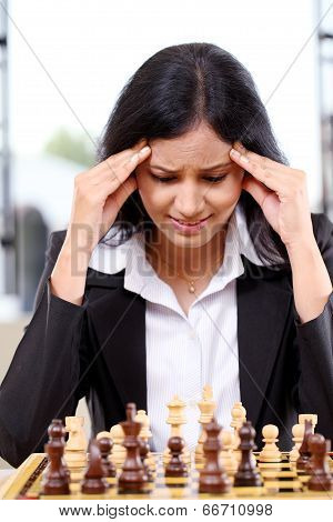 Stressed Business Woman Playing The Chess Game