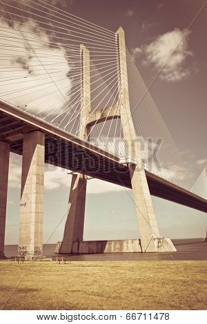 Vasco da Gama bridge in Lisbon, Portugal with retro effect applied.