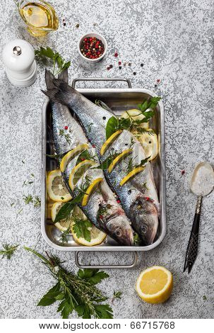 Sea bass with lemon,herbs and persian blue salt before cooking