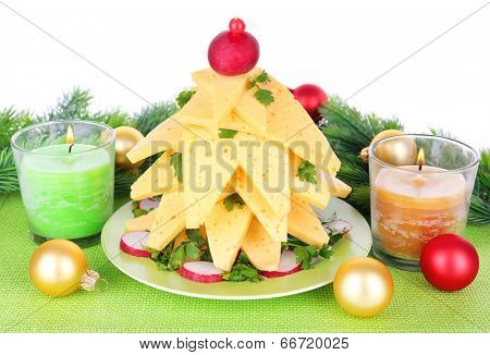 Christmas tree from cheese on table on white background
