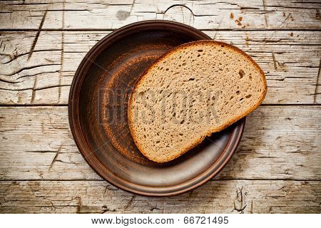 rye bread in a plate on rustic wooden background