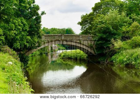 Stone Bridge Over The White Cart Water In Pollok Country Park In Glasgow, Scotland, Uk