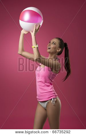 Funny Girl Playing With Beach Ball