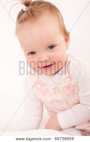 Beautiful expressive adorable happy cute laughing smiling baby girl face  isolated.