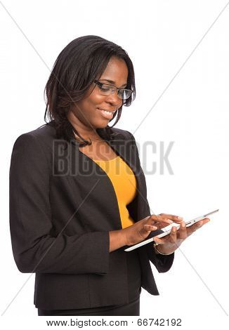 Laughing Young African American Female Businessman Holding a Touch Pad Tablet PC on Isolated White Background