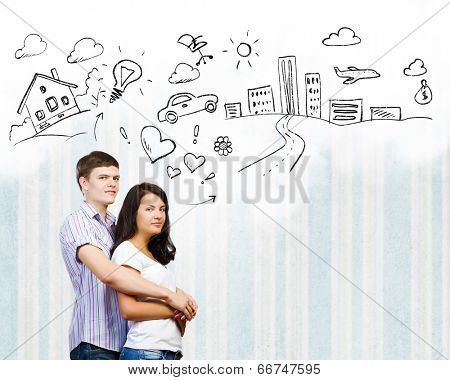 Young couple hugging each other and dreaming about future