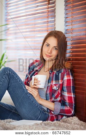 Young Woman Holding A Cup