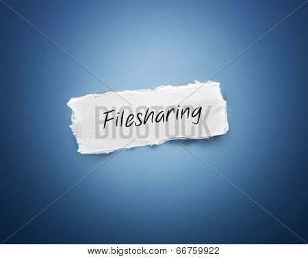 3d rectangular scrap of torn white paper with the word - Filesharing - in script resembling handwriting on a blue background with a vignette and copyspace