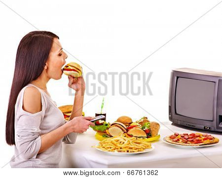 Woman eating fast food and watching TV. Isolated.