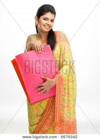girl with sari carrying shopping bags