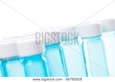 Full vial with vaccine on a white background