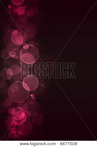 Pink Bokeh Against A Dark Burgundy Background
