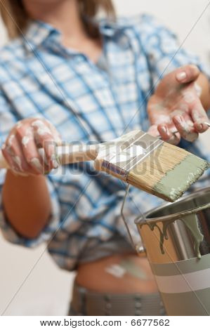 Home Improvement: Woman Holding Paint Brush