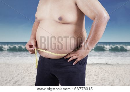 Fat Man Measuring His Stomach Size
