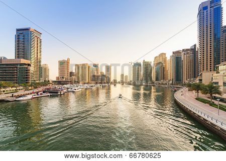 DUBAI, UAE - MARCH 30: City scenery of Dubai Marina on March 30, 2014, UAE. Dubai Marina is a district in Dubai with artificial canal skyscrapers who accommodates more than 120,000 people.