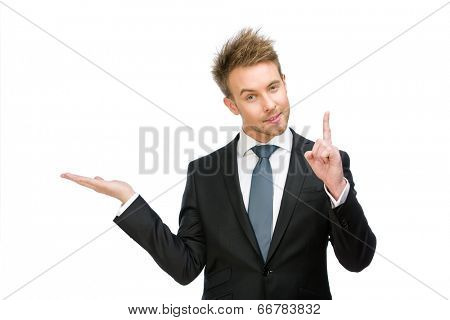 Half-length portrait of business man with palm up forefinger gestures, isolated on white. Concept of leadership and success