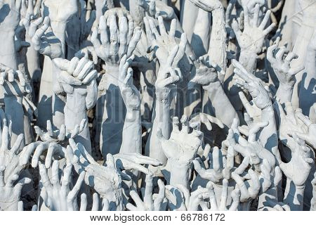 Sculptures of famous Wat Rong Khun (White temple) in Chiang Rai province, Northern Thailand