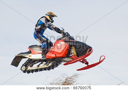 Flying sportsman on snowmobile